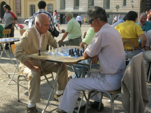Two men play chess in Plaza de Armas